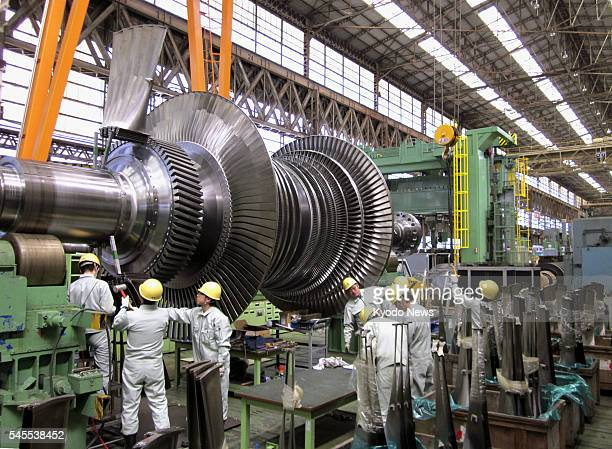 Hitachi Japan Workers assemble a turbine for thermal power generation at a plant of Hitachi Works an arm of Hitachi Ltd in Hitachi Ibaraki Prefecture...