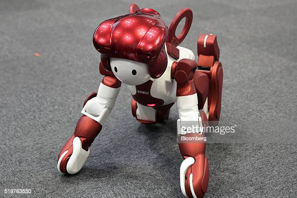 Hitachi Ltd.'s Emiew3 humanoid robot stands up after it fell during a demonstration at a media briefing in Tokyo, Japan, on Friday, April 8, 2016....