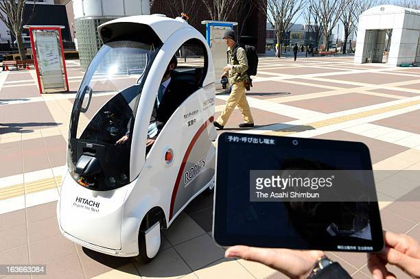 Hitachi unveils its singleseated autonomous vehicle 'Ropits' Robot for Personal Intelligent Transport System which can be called up to the...
