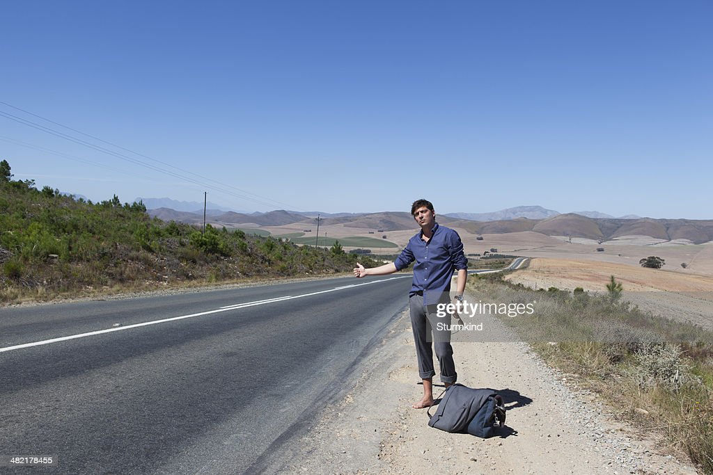 Hitchhikers By Side Of Road >> Hitchhiker On Side Of Road Stock Photo Getty Images