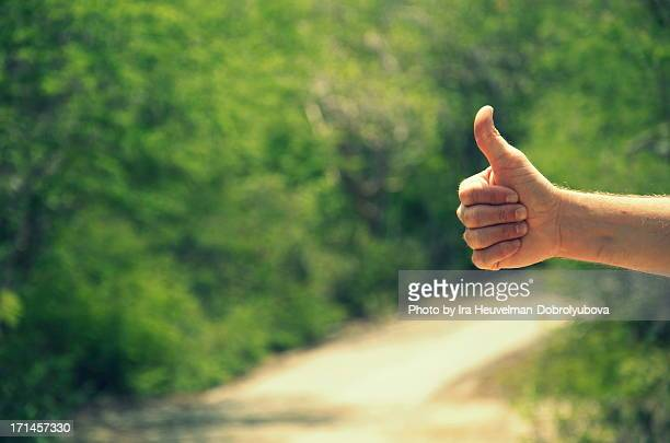 hitchhiking - thumb stock pictures, royalty-free photos & images