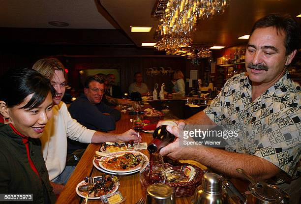 Hitching Post Restaurant's Chef Winemaker Proprietor Frank Ostini pours out his best for couple enjoying the 'Sideways Movie trail' Carol Choi and...