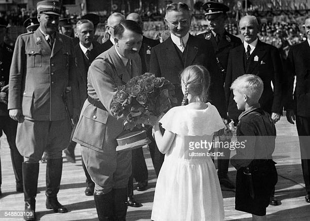 Hitler Adolf Politician NSDAP Germany *20041889 laying of the foundation stone to the new build Reichsbank in Berlin children presenting a bouquet of...