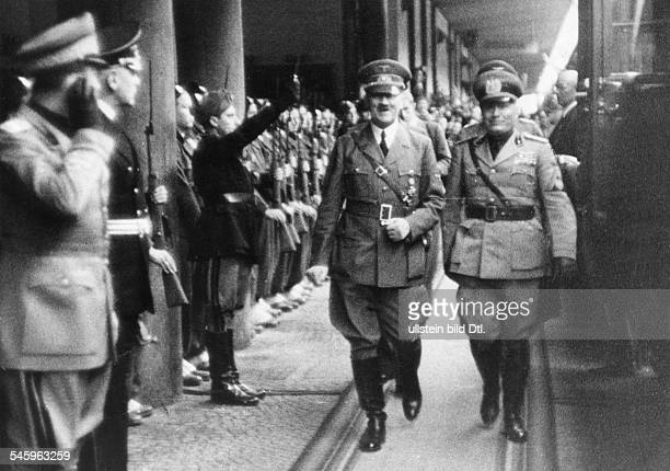 Hitler Adolf Politician NSDAP Germany *20041889 Adolf Hitler and Benito Mussolini after the arrival at the train station on the left italian foreign...