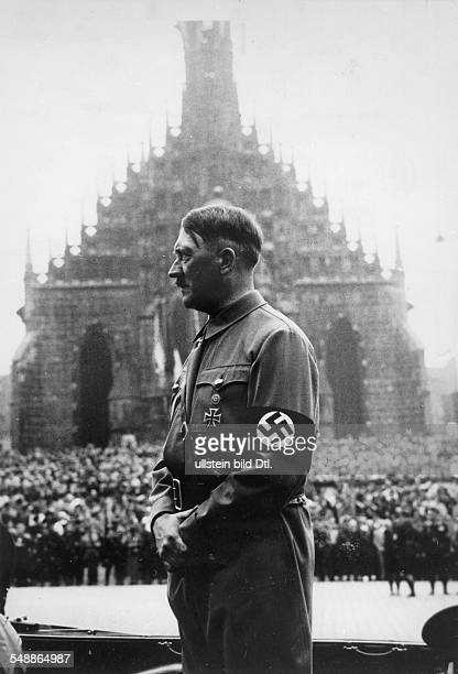 Hitler Adolf Politician NSDAP Germany *20041889 Nuremberg Rally 1937 Marchpast of the 'NS combat units' before Hitler in the background the '...