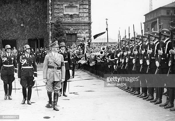 Hitler Adolf Politician NSDAP Germany *20041889 Nuremberg Rally 1938 Adolf Hitler taking the salute of an SS guard of honour after his arrival at the...