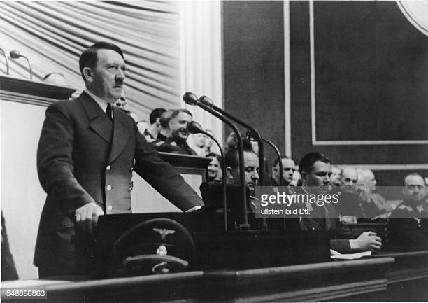 Hitler Adolf Politician NSDAP Germany *20041889 Speech of Hitler at the Reichstag in the Krolloper on the left Reichspressechef Otto Dietrich and...