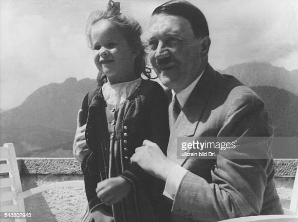 Hitler Adolf Politician NSDAP Germany *20041889 with a girl on the terrace of his house in the region of the Obersalzberg near Berchtesgaden 1937...