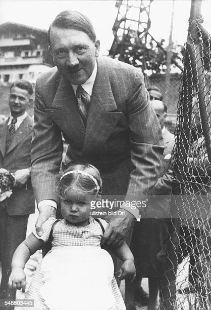 Hitler, Adolf - Politician, NSDAP, Germany *20.04.1889-+ - with a girl on the terrace of his house in the region of the Obersalzberg near...
