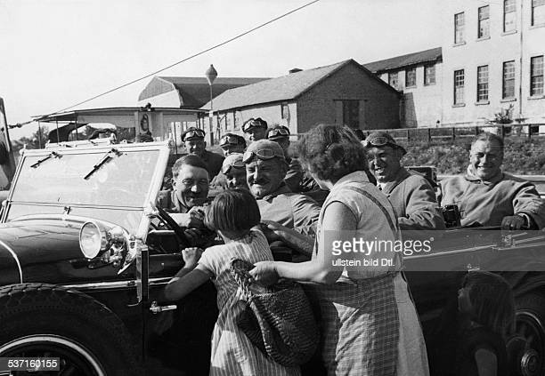 Hitler Adolf Politician NSDAP Germany bgreeting a girl next to Hitler his driver Julius Schreck sitting in the back of the car his personal adjutants...