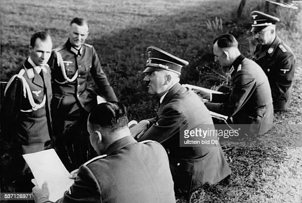 Hitler Adolf Politician NSDAP Germany having a rest at a railway embankment sitting from left Martin Bormann Hitler Rudolf Schmundt Heinrich Himmler...