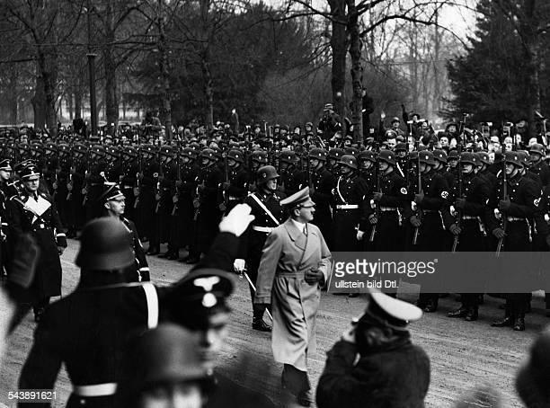 Hitler Adolf Politician NSDAP Germany Taking the salute from a line of SSmen Photographer Heinrich Hoffmann Published by 'Berliner Allgemeine...
