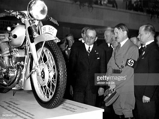 Hitler Adolf Politician NSDAP Germany*20041889 at the motorshow in Berlin looking at a new type of DKWmotorbike Photographer PresseIllustrationen...
