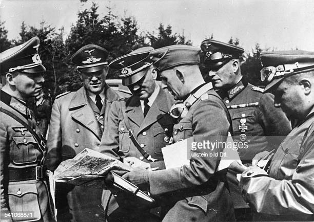 Hitler Adolf Politician NSDAP Germany*20041889 Hitler at a briefing with German generals in Poland from left Erwin Rommel KarlHeinrich Bodenschatz...