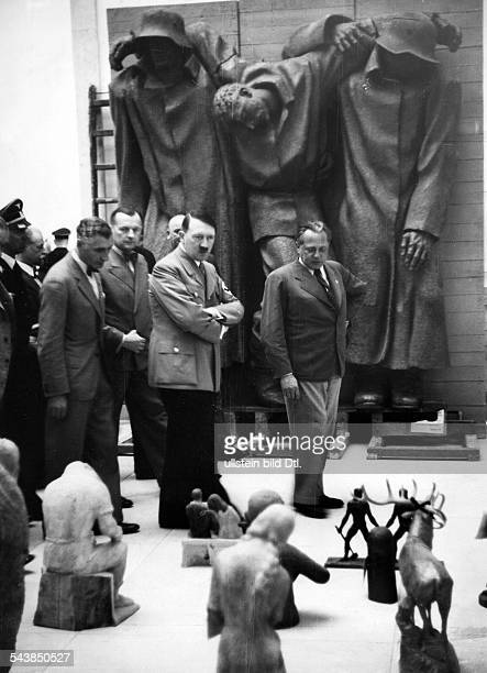 Hitler Adolf Politician NSDAP Germany*20041889 visiting an exhibition of art at the Haus der Deutschen Kunst in Munich on the right Heinrich Hoffmann...