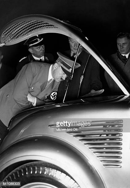 Hitler Adolf Politician NSDAP Germany*20041889 visiting the motor show in Berlin in the background his personal adjutant SSFuehrer Julius Schaub...