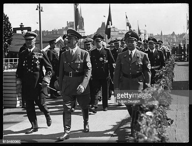Hitler and Miklos Horthy Regent of Hungary walk on a landing bridge during Horthy's visit to Hamburg on Hitler's 50th birthday