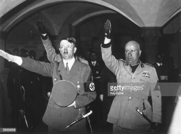 Hitler and Mussolini giving the Fascist salute at the Tomb of the Fascist Martyrs in Florence