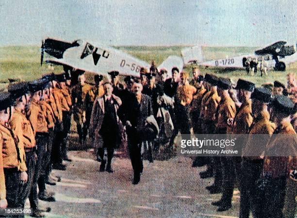 Hitler arrives at a German airbase and reviews an SA honor guard circa 1932-34