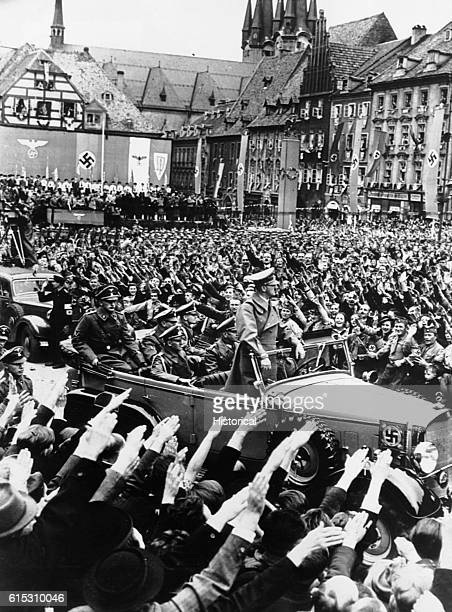 Hitler enters the Czech city of Eger surrounded by a saluting crowd. Ca. 1939-1945. | Location: Eger, Czechoslovakia.