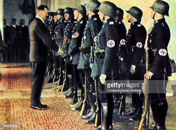 Hitler greet some of his guards at the Chancellor's Office in Berlin 1935