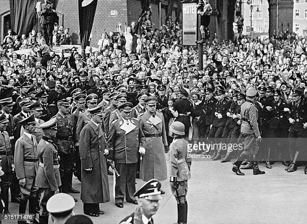 Hitler greeted in Berlin after Munich 'victory' Berlin Germany The scene at the Anhalter railway station her as storm troopers hold back part of the...