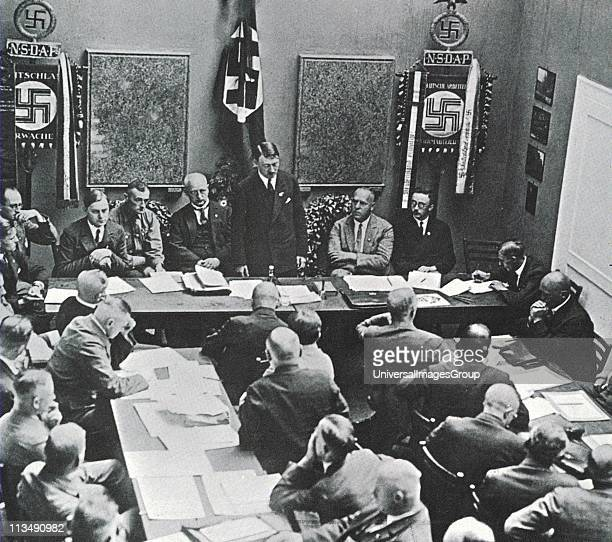Hitler in Munich adressing a meeting of the NSDAP in 1925 Third to the left of Hitler is Alfred Rosenberg on the right are Gregor Strasser and...