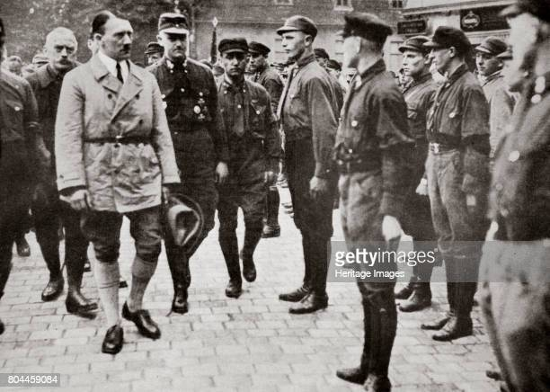 Hitler inspecting a group of SA Members during World War II Germany 19391945 Founded in c1919 the Sturmabteilung was the paramilitary wing of the...