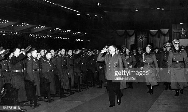 Hitler leaving the inspection of officer cadets in the Sportpalast in Berlin behind Hitler are general Walther von Brauchitsch and adjutant Rudolf...