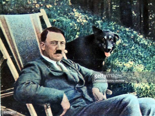 Hitler on vacation with a dog seated adjacent to him 1934