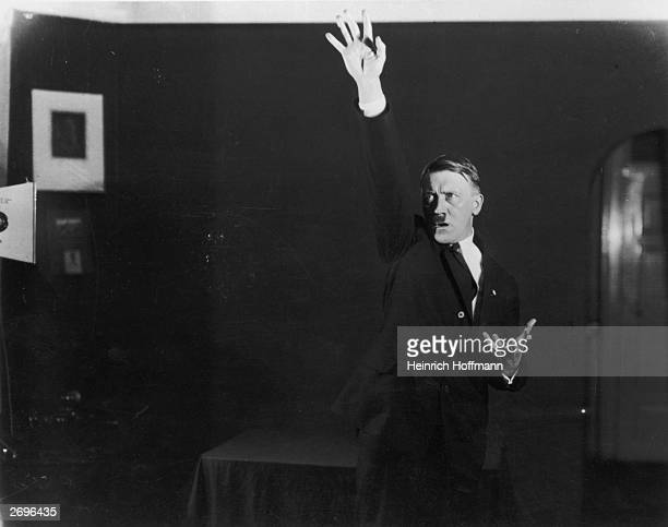 Hitler posing to a recording of one of his speeches after his release from Landsberg Prison