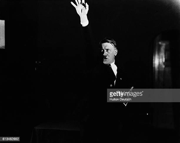 Hitler practices his speech making in front of a photographer so he can study their dramatic impact