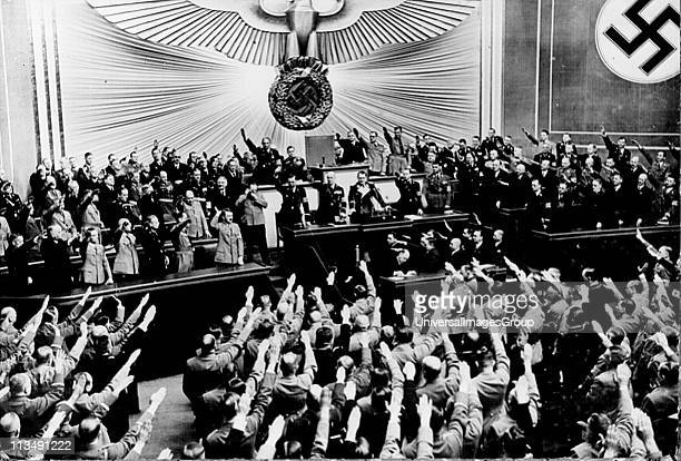Hitler receives Nazi salutes after a speech in the Reichstag in 1934