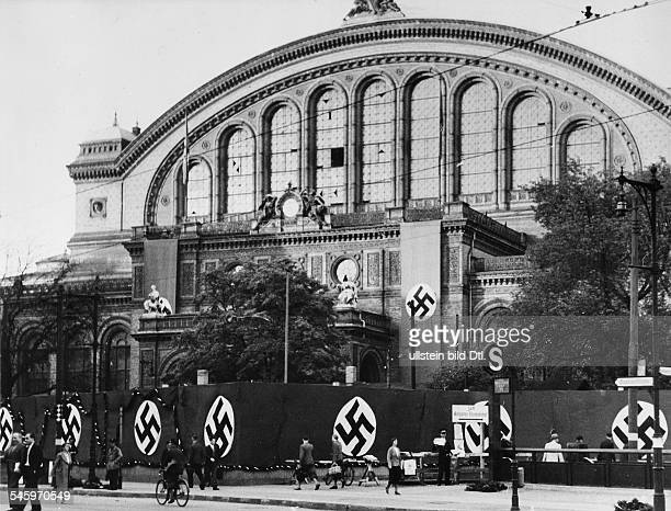 Hitler returning to Berlin after signing the armistice with France the station Anhalter Bahnhof decorated with Swastika flags Photographer Herbert...