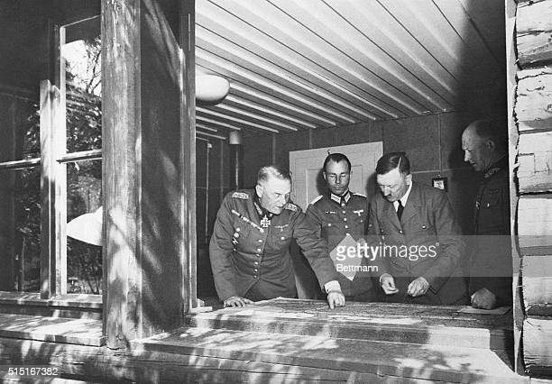 Hitler Studies War Plans At the Fuhrer's Headquarters on the western front Adolf Hitler is explained the manner in which the German forces are...