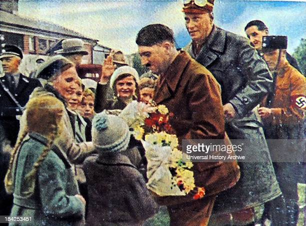 Hitler with adoring supporters These photographs were taken to enhance the father of the nation status of Adolf Hitler after he became Chancellor of...
