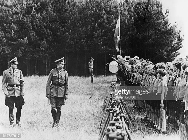 Hitler Youth leader Artur Axmann and General Heinz Guderian review a formation of the East Prussian Hitler Youth who were detailed to build a trench