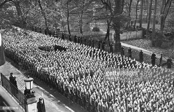 Hitler Youth parading in Munich in front of the 'Brown House' before the celebration of their admission into the NSDAP party November 9 Weimar...