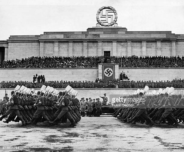 Hitler's Military Labor Service Corps march in review before Hitler's podium at Zeppelin Field at Nuremberg Germany in 1938