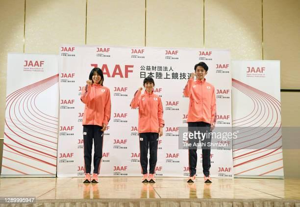 Hitomi Niiya, Nozomi Tanaka and Akira Aizawa pose during a press conference on December 5, 2020 in Osaka, Japan.