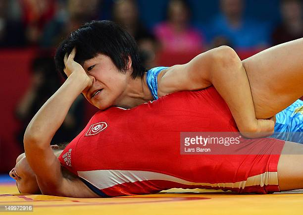 Hitomi Obara of Japan competes against Maroi Mezien of Tunesia in the Women's Freestyle 48 kg Wrestling on Day 12 of the London 2012 Olympic Games at...