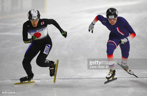 Hitomi Saito of Japan and Yara Kerkhof of Netherlands start during the men's 1000m quarterfinal event at the ISU World Cup Short Track Speed Skating...