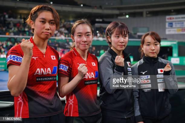 Hitomi Sato, Kasumi Ishikawa, Miu Hirano and Mima Ito of Japan pose for photographs after winning Women's Teams - Quarterfinals - Match 4 on day...