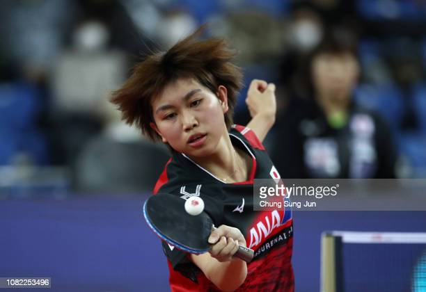 Hitomi Sato of Japan competes in the Women's Singles Round of 16 against Yuling Zhu of China during day two of the World Tour Grand Finals at Namdong...