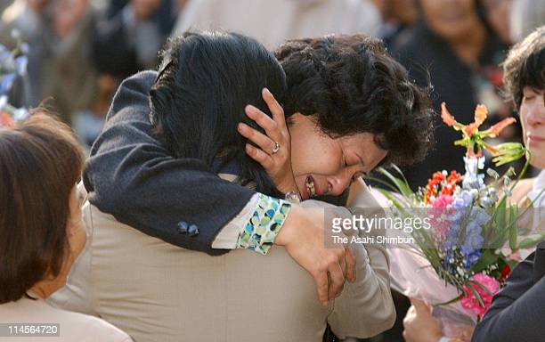 Hitomi Soga hugs to her friend at Mano City Hall on October 17 2002 in Mano Niigata Japan Five of 13 Japanese nationals that North Korea has admitted...