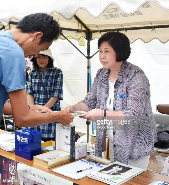 Hitomi Soga, one of five Japanese abductees repatriated to Japan from North Korea in 2002, collects signatures seeking an early resolution of the...