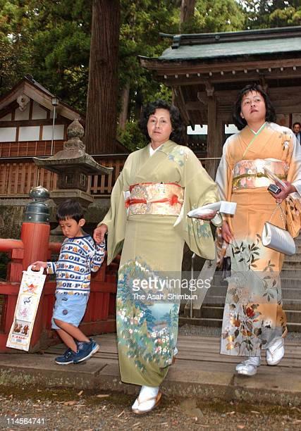 Hitomi Soga wearing Kimono attends the celebration ceremony of her nephew's 5 years old at Watatsu Shrine on October 19 2002 in Hamochi Niigata Japan...