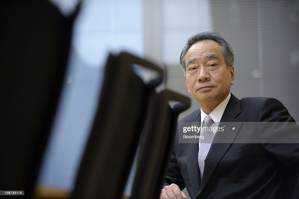 Hitoshi Tsunekage, chairman of Sumitomo Mitsui Trust Holdings Inc., poses for a photograph in Tokyo, Japan, on Tuesday, Dec. 25, 2012. Nikko Asset Management Co., the unit of Sumitomo Mitsui Trust Holdings Inc. that shelved an initial public offering in 2011, must reap 'sustainable' profit gains before listing its stock, Tsunekage said. Photographer: Akio Kon/Bloomberg via Getty Images
