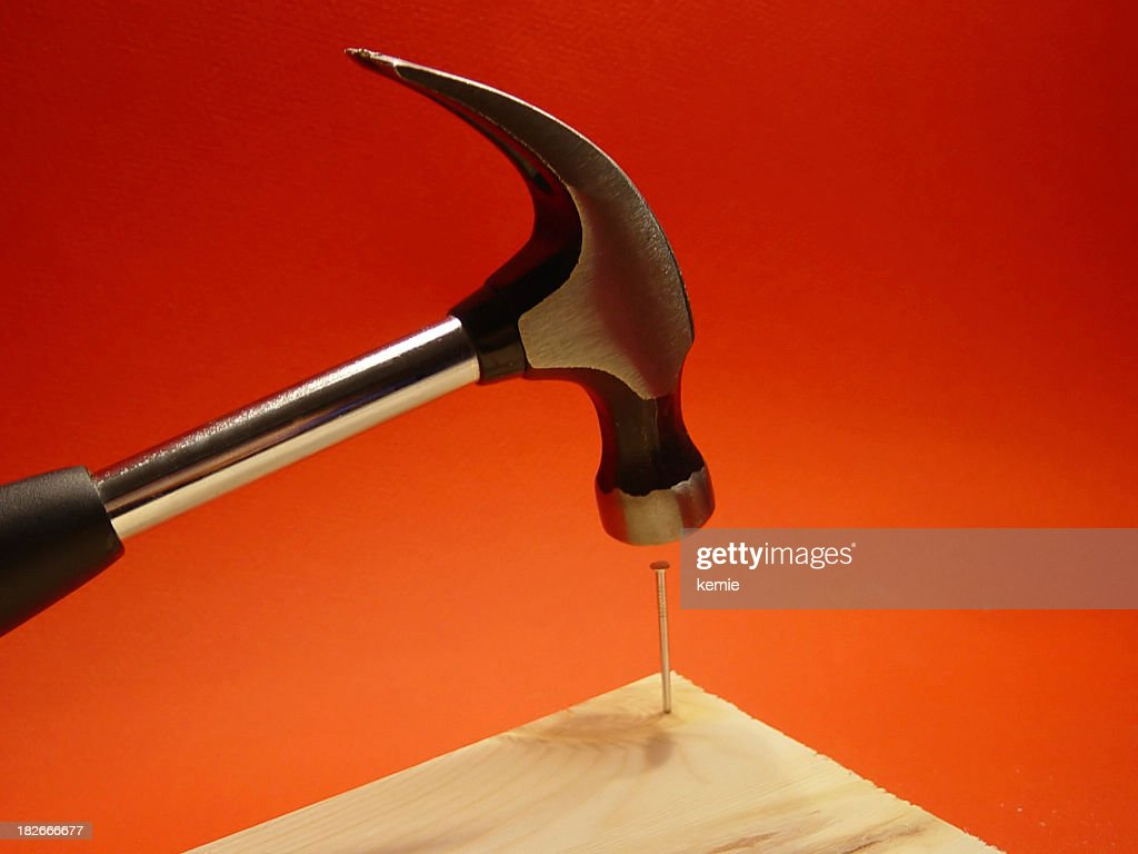 Hitting A Nail On The Head With A Hammer Stock Photo | Getty Images