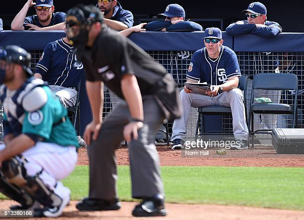 Hitting coach Alan Zinter of the San Diego Padres looks on from in front of his bench during the fourth inning against the Seattle Mariners at Peoria...